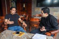 محمد عبد الواحد مع محرر سوبر كورة